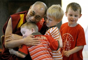 Tibetan spiritual Leader his holiness the Dalai Lama hugs children in the Saint Nikolaus church in the western German city of Bochum on May 16, 2008